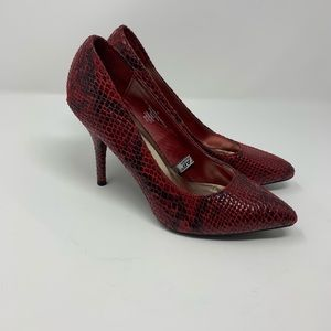 Red Heels with Snake Print Design.